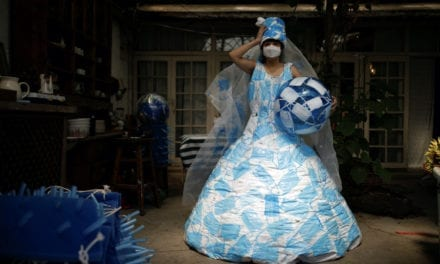 Chinese Artist Creates Wedding Dress Made From Masks to Show Hope
