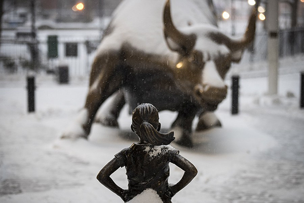 Fearless Girl Confronts Bull, Then Moves To Wall Street